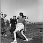 girl swinging baseball bat 1