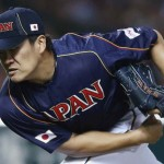 Japan's pitcher Tanaka pitches against Cuba at the WBC qualifying first round in Fukuoka
