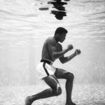 Cassius Clay training in a pool at the Sir John Hotel in Miami, 1961