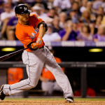 DENVER, CO - JULY 23: Giancarlo Stanton #27 of the Miami Marlins hits a solo home run to left field during the eighth inning against the Colorado Rockies at Coors Field on July 23, 2013 in Denver, Colorado. The Marlins defeated the Rockies 4-2. (Photo by Justin Edmonds/Getty Images)